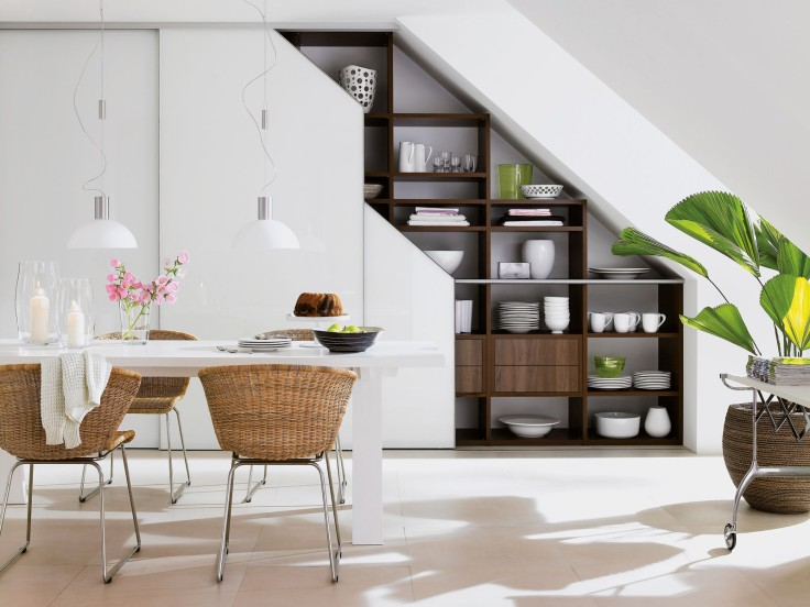 interesting-stairway-storage-ideas-with-wooden-plat-shelves-under-stairs-plus-pendant-lam-above-white-dnig-table-with-rattan-chair-near-stair-for-dining-room.