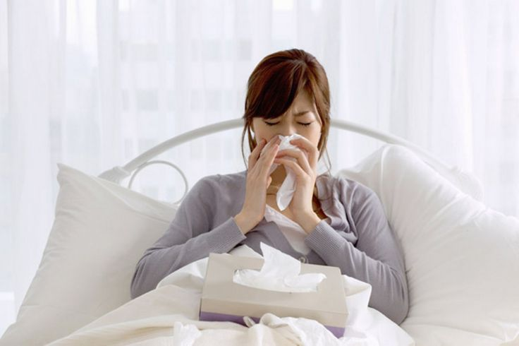 A woman in bed with flu